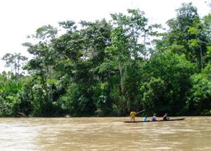canoe on a muddy Amazon river