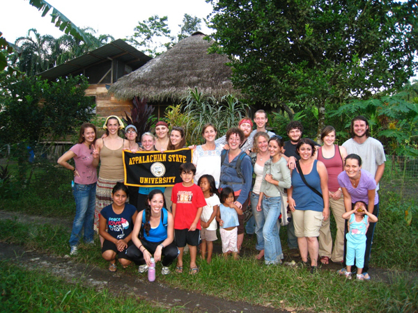group photo with App State banner in Ecuador