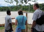 Native Ecuadorian man talking to two students