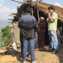 Author talking with disaster-affected community members