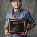 Dr. Gregory Reck with award plaque